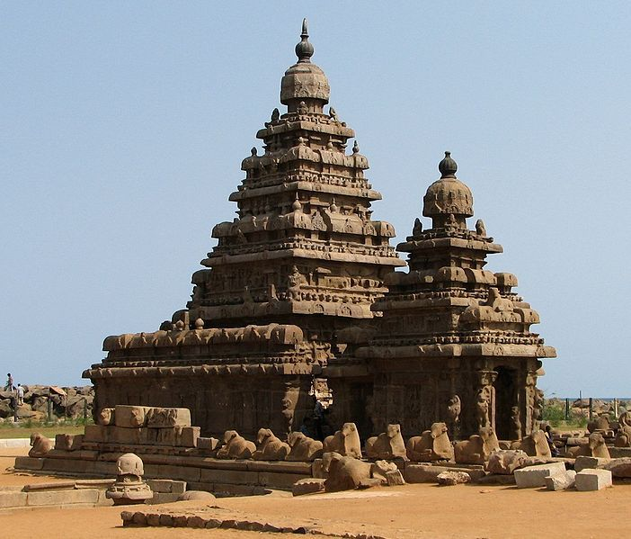 The Shore Temple (built in 700-728 AD) is so named because it overlooks the shore of the Bay of Bengal. It is a structural temple, built with blocks of granite, dating from the 8th century AD. It was built on a promontory sticking out into the Bay of Bengal at Mahabalipuram, a village south of Chennai in the state of Tamil Nadu in India. The village was a busy port during the 7th and 8th century reign of the Pallava dynasty during the reign of Narasimhavarman II