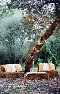 Create your own sitting area under a tree with a few bales of hay & some pillows!