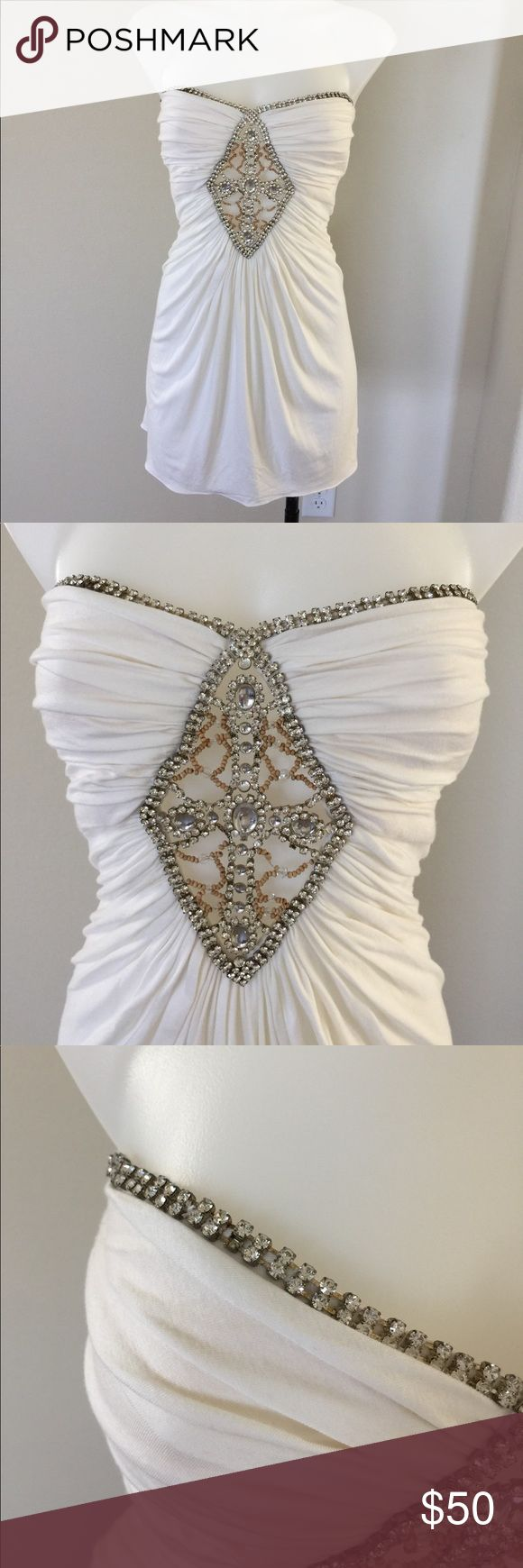 Sky cream rhinestone dress/top Gently worn , size XS, stretchy , rhinestone detail , one rhinestone missing as shown but not noticeable, approx 23 inches from top to bottom Sky Dresses Strapless
