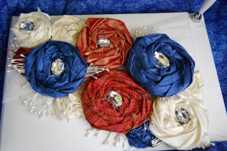 How to customize a wedding guest book with recycled fabric flowers.