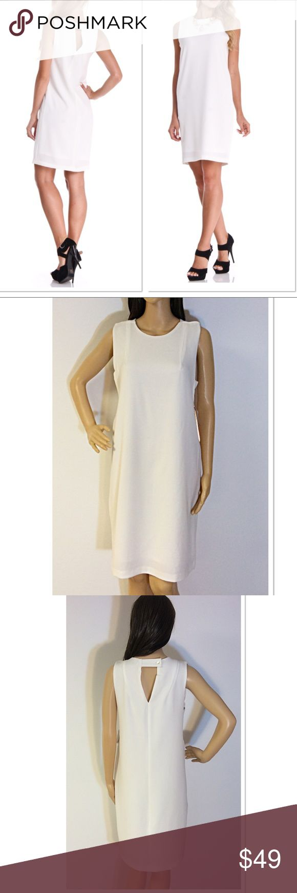 """DEX THE SUIT SHOP IVORY SHEATH DRESS Gorgeous dress with a keyhole back and loose fit. Fully lined. Very classy IVORY color. Measurements lying flat Bust 18.5"""" length 37"""".  Color is more like photos on mannequin instead of stock photos. Stunning piece. Dex The Suit Shop New York Dresses Midi"""