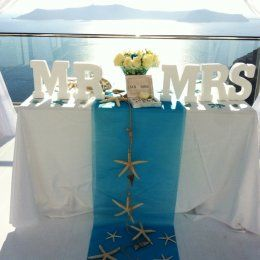 Summer theme and wooden MR & MRS sign in Santorini.