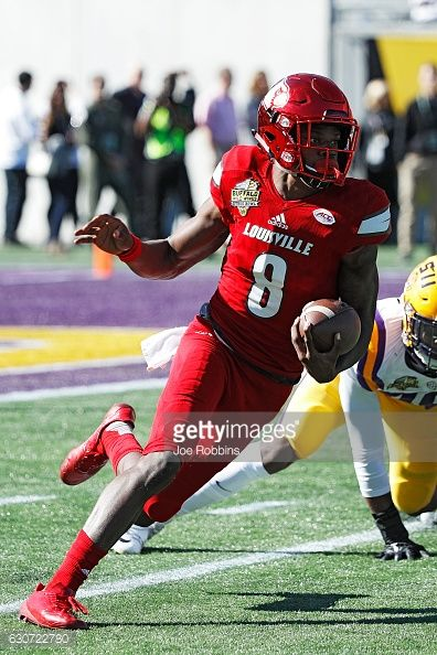 News Photo : Lamar Jackson of the Louisville Cardinals runs...