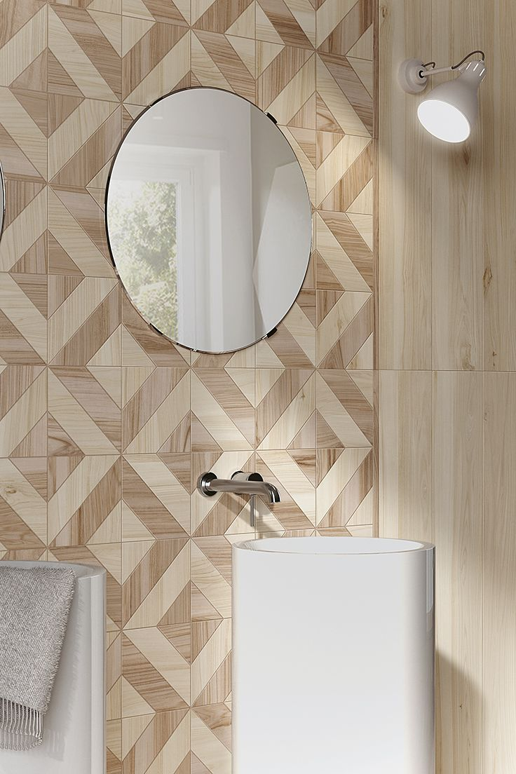 KORU is the new collection of porcelain stoneware strips by Mirage, a project that seeks to offer a reinterpretation of the types of wood of fruit trees. #miragetile #porcelaintiles #wood #wall #bathroom #bathroomdesign