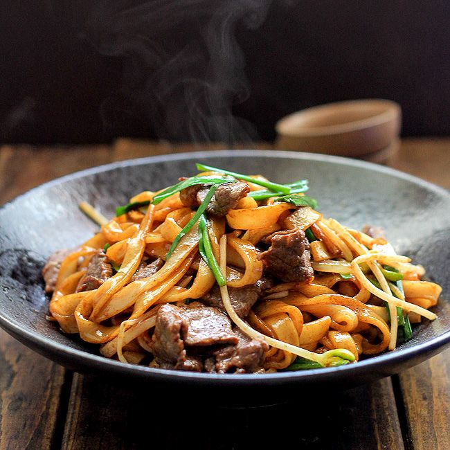 Beef Chow Fun - Beef stir-fried with rice noodle, bean sprouts, spring onions and Chinese chives is a famous Cantonese dish ; asian ; noodles