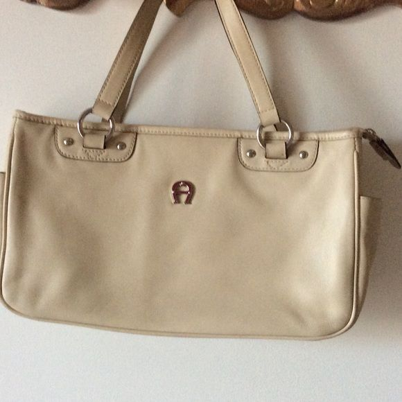 Etienne Aigner vintage satchel. REDUCED Cream colored leather.  Two large compartments separated by zippered section.   Very nice condition on outside.  Interior has a few ink marks but pretty nice. Etienne Aigner Bags Satchels