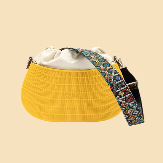 O swing, the baguette bag in a knit-effect texture.  Inspired by the straw baskets, this new model is the shoulder strap of this summer.  Perfect for your downtown free time with its braided cloth accessories and gipsy-folk pendants. Must have woven details to personalize!   .rock your summer  #Obag #summer #mixandmatch