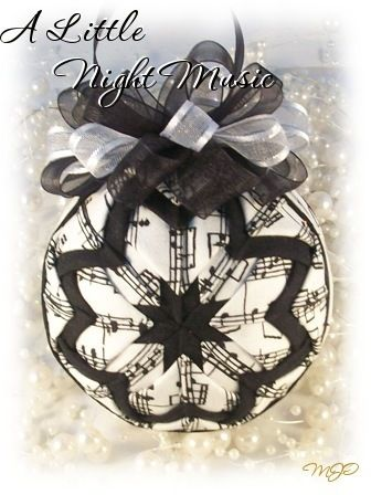 This beautiful black and white musical themed ornament is great for music lovers by Miss Joy's Ornaments