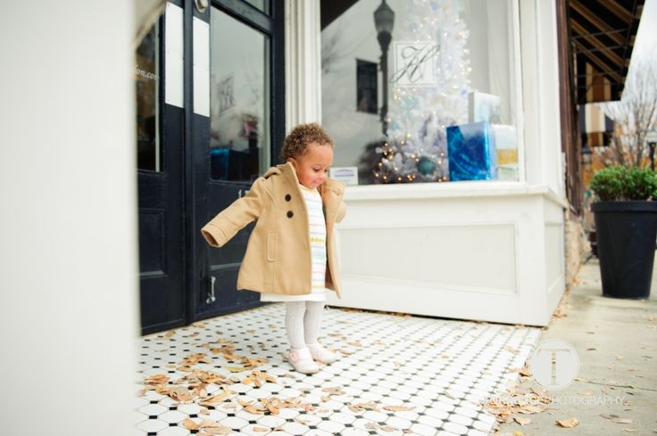 The sweet little jacket, the leaves, the cool tile, those adorable curls--she just owns it all. http://www.torrencephotography.com