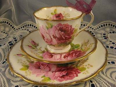 This is the set my mom has.American Rose ~ TEA CUP, SAUCER & LUNCH PLATE ~ TRIO by Royal Albert