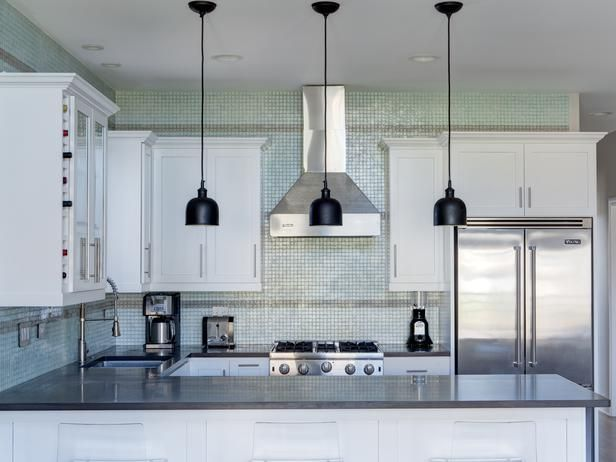 Contemporary kitchens from brian patrick flynn glass mosaic tile behind white cabinets and dark gray