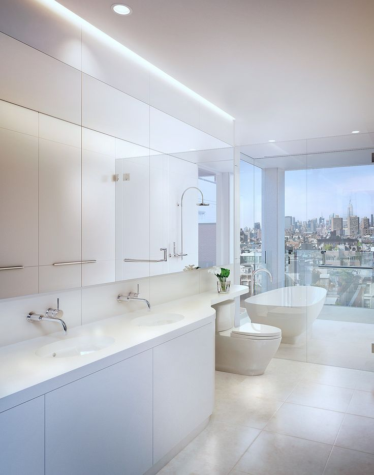 The bathrooms feature heated floors and polished chrome fixtures.