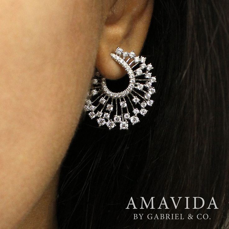 Let the sparks fly with these stunningly abstract 18k white gold diamond drop…