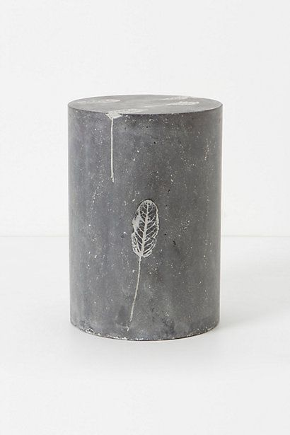 Fallen Leaves Cement Stool - Fusing nature and minimalist design, concrete is poured into a mold and pressed with a flurry of fallen leaves before being stained slate grey. By Bevara Design House.