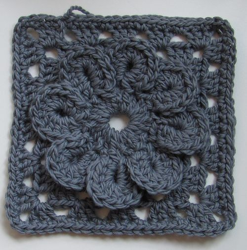 Granny Square with Flower   Tutorial (in both Swedish and English) at Virkning-Crochet