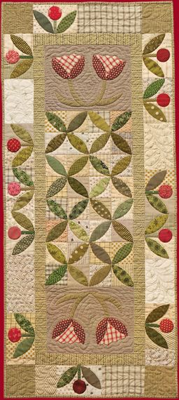A nice long table runner with appliqued flowers! Amish Grace quilt by Norma Whaley