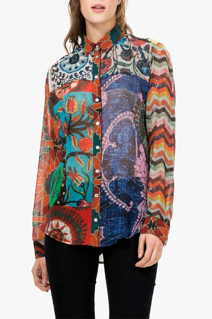 """This sheer top is a beautiful mix of ethnic prints that are inspired by ancient patterns. It features a double yoke, full button front, button sleeves, and longer shirt tail hem. Tuck into skirts and pants to wear for work or wear out over jeans for a casual look. The European size small measures 27"""" in the front and 28"""" in the back, 19.5"""" across the bust, and the sleeves are 23.5"""" from the shoulder. Please note that the American size is one size smaller than the European size.   Silky Print…"""
