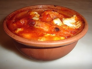 Prawn Saganaki can be served as a starter or a side dish and is actually quite filling. The Greek drink ouzo is used as is Greek feta cheese. It is served in the individual ceramic bowls which are placed in front of the guests piping hot!