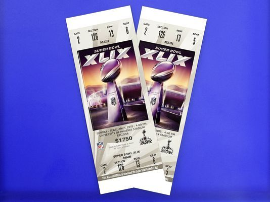 These are Super Bowl tickets for the Feb. 1, 2015, Super Bowl at the University of Phoenix Stadium in Glendale. This image has been altered to remove the ticket number and bar code for security/anti-counterfeiting purposes. (Photo: Tom Tingle/The Republic)