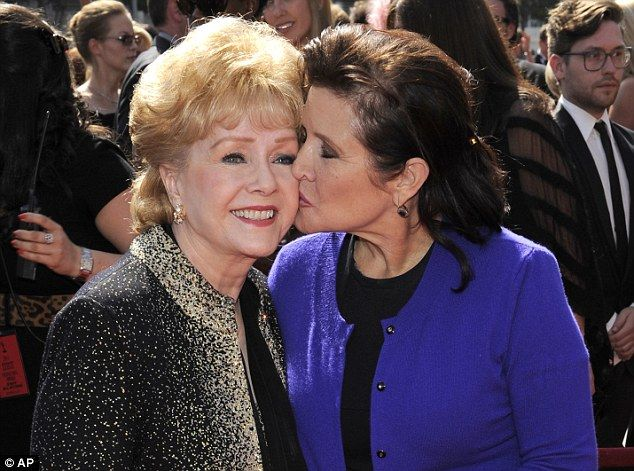 The pair reconciled after a 10 year estrangement when Fisher was in her twenties. Above, she is seen kissing her mother in 2011