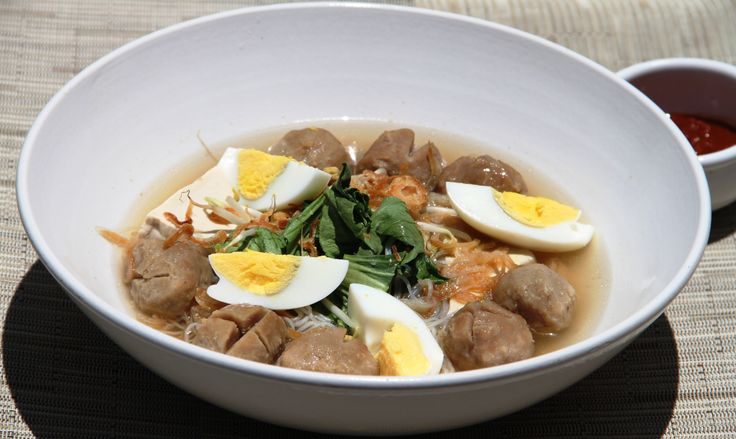 Bakso Meatball in beef broth, bihun (rice vermicelli), salted vegetables, tofu, eggs,  Chinese green cabbage and bean sprouts