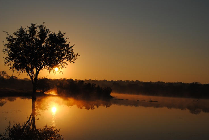 Sunrise over the lake at Chitwa Chitwa Game Lodge, South Africa