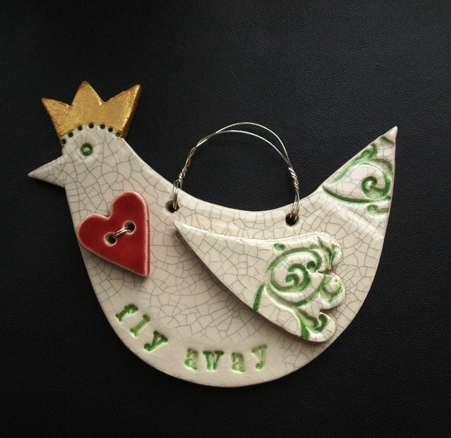 Ceramic bird decoration with crown and heart