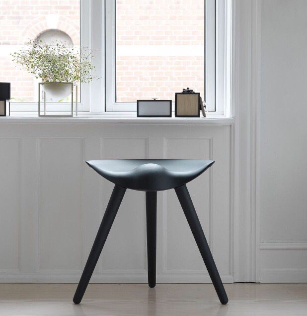 The ML42 stool in black stained beech stands out against an interior of lighter tones. The stool was originally designed in 1942 by the architect Mogens Lassen and is still made in Denmark. #bylassen #bylassenML42 #ml42 #ml42barstool #ml42stool #stool #barstool #danishdesign #nordicdesign #scandinaviandesign #madeindenmark