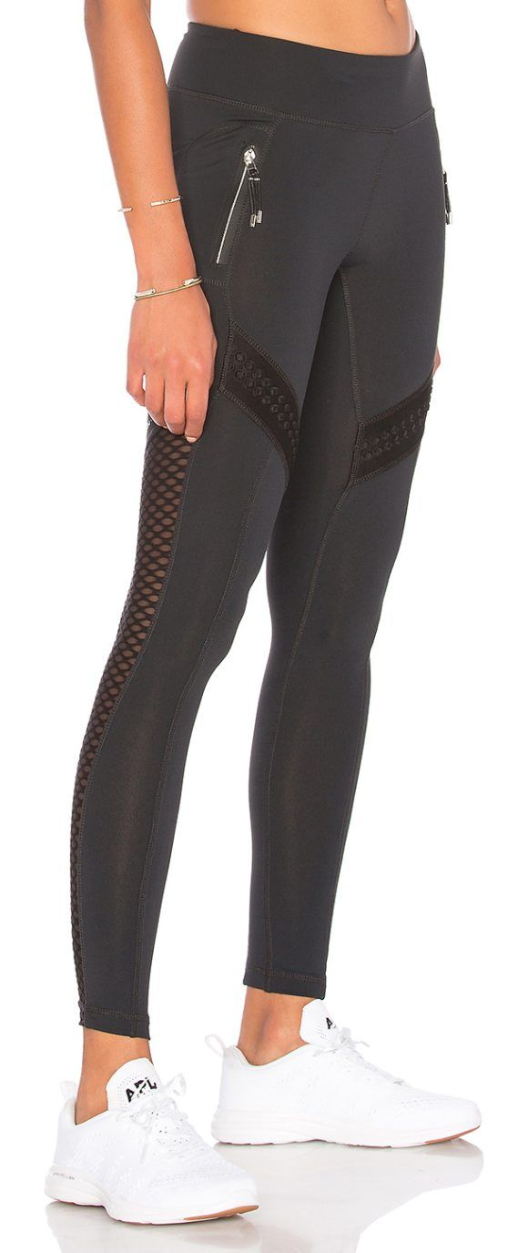 Okami Mesh Legging by lukka lux. Self: 89% nylon 11% spandexContrast: 93% poly 7% spandex. Stretch fit. Side zipper pockets. Contrast mesh panel accen...