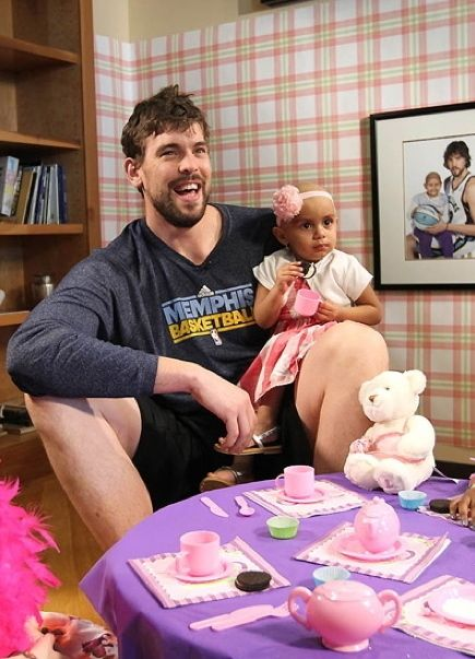 My heart just melted into a little puddle on the floor. (Marc Gasol of the Memphis Grizzlies enjoys a tea party during a visit with children on March 15, 2012, at Memphis Grizzlies House - St. Jude Children's Research Hospital in Memphis, Tennessee. By Joe Murphy/NBAE via Getty Images.)