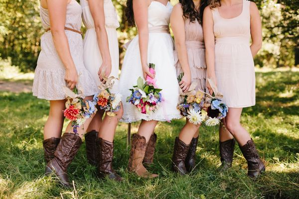 Bridal party sporting their cowboy boots. | Eryn Kesler Photography | ilovefarmweddings.com