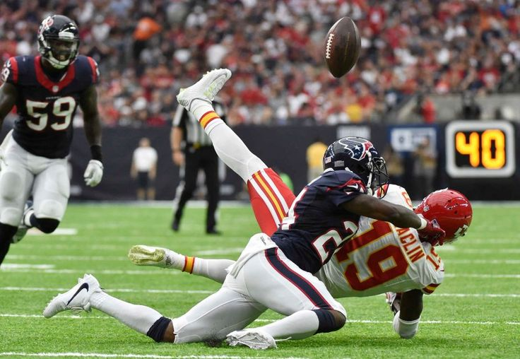 Houston Texans cornerback Johnathan Joseph (24) breaks up a pass intended for Kansas City Chiefs wide receiver Jeremy Maclin (19) during the first half of an NFL football game Sunday, Sept. 18, 2016, in Houston.