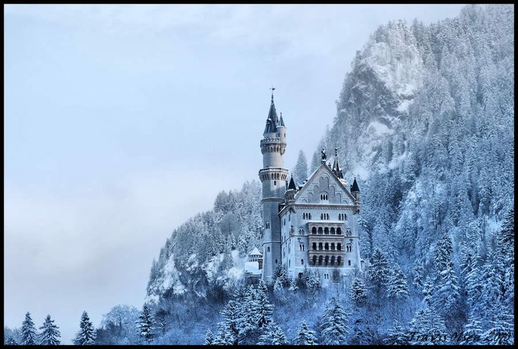 Neuschwanstein Castle, Hohenschwangau, Germany, bathed in snow. An iconic symbol of Romanticism, and one of Europe's most visited tourist destinations.