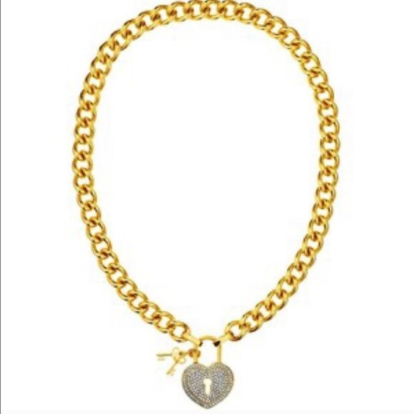 """JUICY COUTURE pave heart padlock necklace Authentic Juicy couture gold chain pace heart padlock  necklace with key charms. All crystals  intact. Absolutely no flaws. Comes with Juicy Couture box.  RETIRED and no longer available.  ❌NO TRADES❌. The heart shaped padlock encrusted with pave is the main focus of this necklace.  Interestingly it's also a key player in its toggle closure.  And speaking of keys, tiny ones dangle from this design.  18""""L . CZ BRASS/STAINLESS STEEL/GLASS. PRICE FIRM‼️…"""