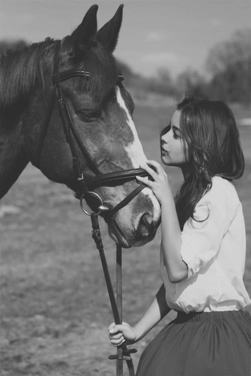.I love this picture. It displays the sweet and gentle relationship between a girl and her horse. <3