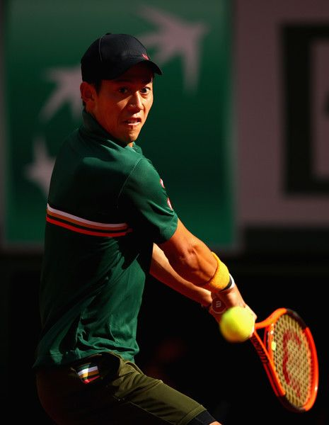 Kei Nishikori Photos Photos - Kei Nishikori of Japan stretches for the ball during mens singles quarter finals match against Andy Murray of Great Britain on day eleven of the 2017 French Open at Roland Garros on June 7, 2017 in Paris, France. 2017 French Open - Day Eleven