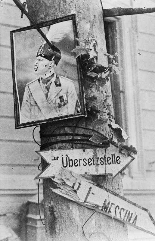 A badly defaced portrait of Mussolini, pierced by a bayonet, hangs from a tree along the road from Messina to the Sicilian ferry crossing to the Italian mainland following the liberation of Sicily on 17 August 1943.