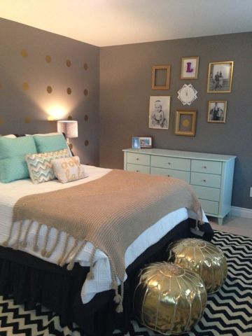 Mint gold and grey bedroom; minus those stupid looking gold ottomans, I'm a fan of the color scheme.