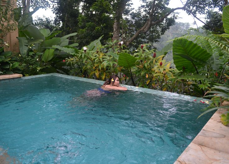Enjoying a dip in the swimming pool. Luxury travel at the Komaneka Tanggayuda Ubud in Bali Indonesia with luxury pool villas. For more on Bali and travel in Southeast Asia check our travel blog: http://live-less-ordinary.com/