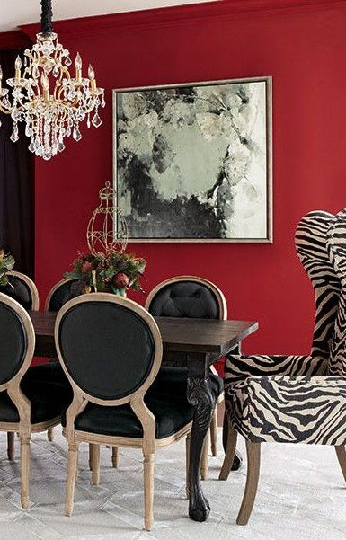 black and white dining room with a pop of red
