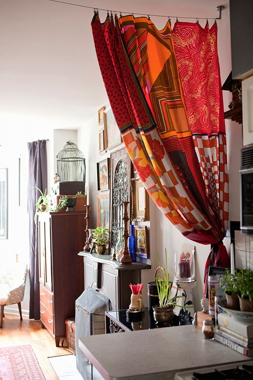 Curtains can be highly useful for a small apartment -- use a light, colorful material to help divide your living room and your kitchen and make them separate spaces when you want! | design-sponge.com