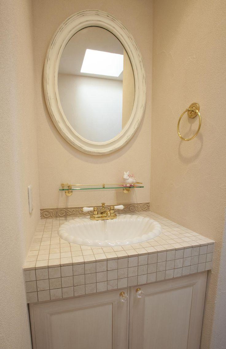 新進建設オリジナルのタイルを使った、可愛い造作洗面化粧台。 かわいい 造作洗面 洗面 洗面台 洗面ボウル 丸鏡 