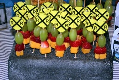 Train party ideas: Strawberries, grapes, and cheese squares were used with railroad crossing signs for a fun snack.