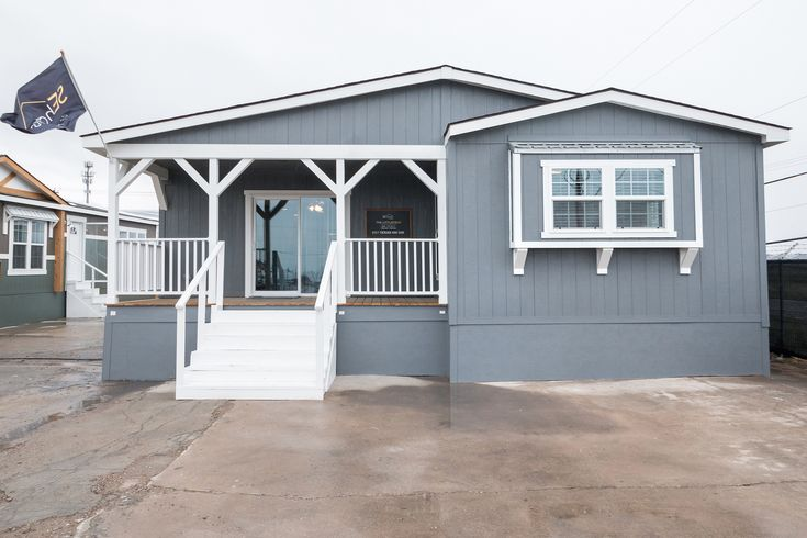 Littlefield mobile home model with porch by Clayton SEhomes