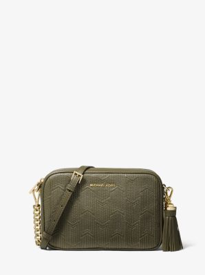 24903af435ef The Ginny crossbody strikes the perfect balance between understated and  luxe, with a lightly structured and compact design that's rendered in  deco-quilted ...