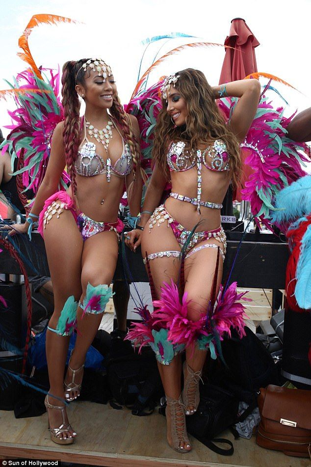 Wow: Kim Kardashian-lookalike Melissa Molinaro (R) and model Liane V put on an eye-popping display at Hollywood Carnival Celebration on Sunday