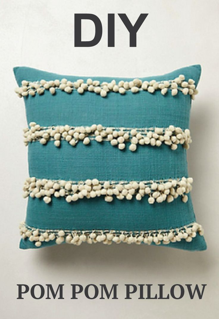We LOVE these fun pom pom pillows!
