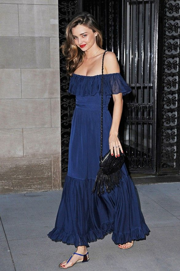 Miranda Kerr looks beautiful in a deep blue off-the-shoulder Gucci maxi dress and side-swept tresses.