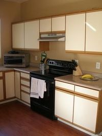 Updating laminate cabinets - Must get this paint for the kitchen cabinets! Cabinet Rescue and available at Home Depot