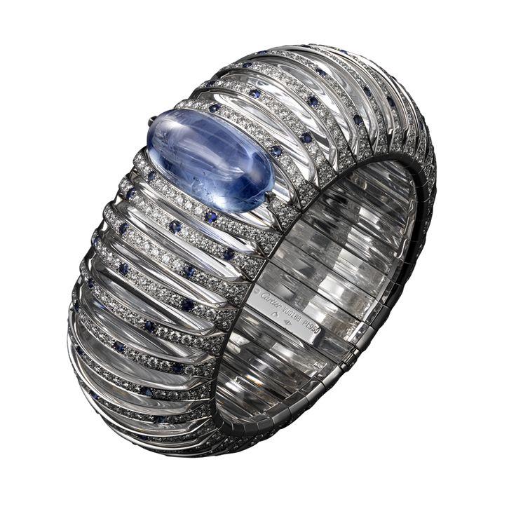 BRACELET  Platinum, one 41.00-carat cabochon-cut sapphire, rock crystal, cabochon cut sapphires, brilliants.